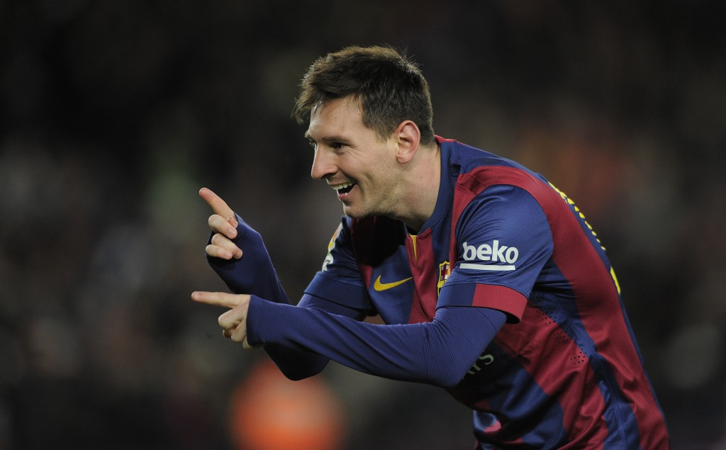 FC Barcelona's Lionel Messi, from Argentina, reacts after scoring during a Spanish La Liga soccer match against Espanyol at the Camp Nou stadium in Barcelona, Spain, Sunday, Dec. 7, 2014. (AP Photo/Manu Fernandez)